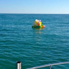 balloons floating on ocean