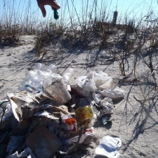 single-use plastic and balloons found on beach