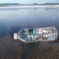 Unopened plastic bottle of water washed ashore