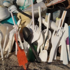 Pile of plastic single-use items collected on beach