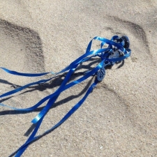 Latex balloon and ribbon littering New Jersey beach