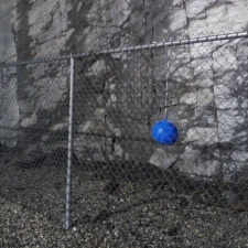 Latex balloon caught on fence