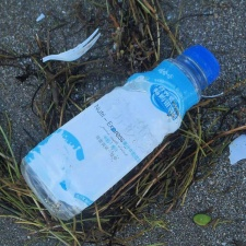 Nutri-Express plastic bottle on beach