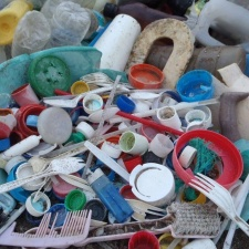 Pile of plastic bottles and containers on beach