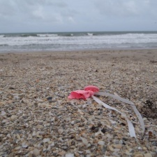 latex balloon and ribbon polluting beach