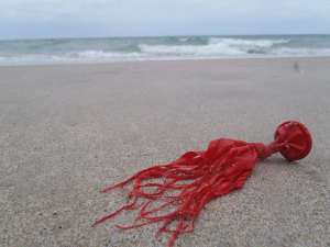 shredded latex balloon littering beach