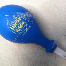 Superior Plumbing of Kennesaw Georgia - Balloon Trash on Beach