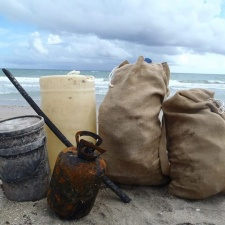 2 Bags of beach debris, metal tank and 2 plastic containers