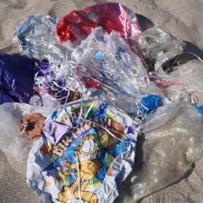 24 balloons littering beach