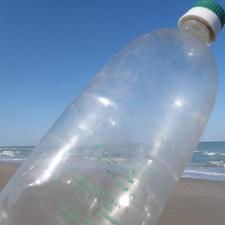 plastic bottle from Cuba on beach