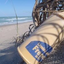Foreign Brake Fluid Plastic Bottle on Beach