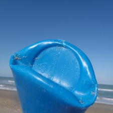 Foreign plastic bottle on beach