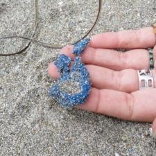 latex balloon piece in beach sand
