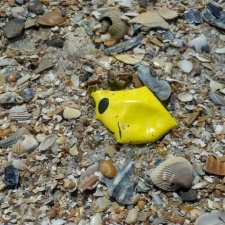 Piece of Smile balloon littering beach