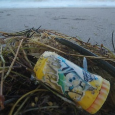 Plastic candy container from Mexico on beach