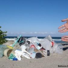 Plastic pollution, fishing line, glass bottle debris on beach