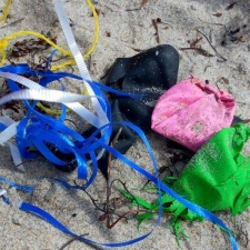 Shredded latext balloons in ribbon in beach Ocean Ridge, Florida