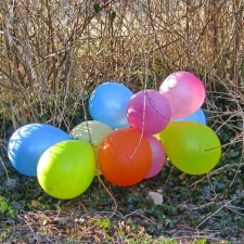 bunch of colorful latex balloons on ground