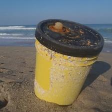 corosive plastic container on beach