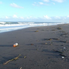Gatorade plastic bottle on beach